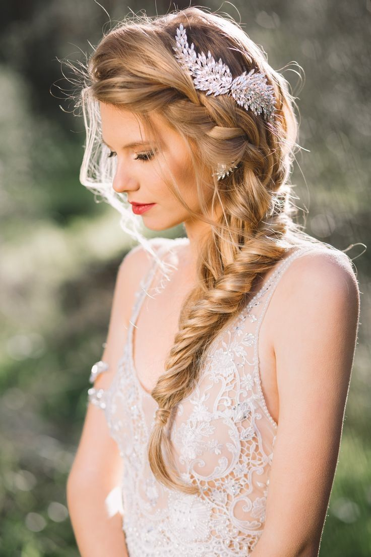 French braided wedding hairstyle with gold wing