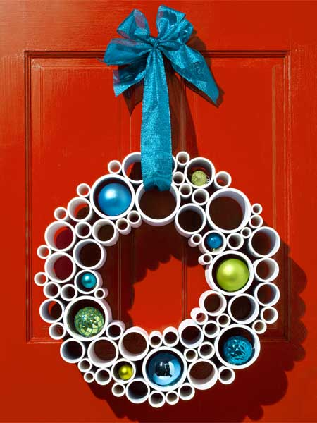 DIY christmas wreaths on a red door
