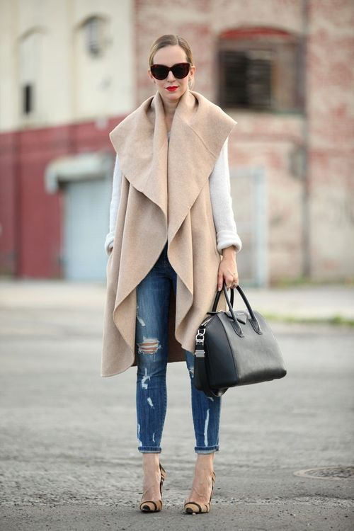 Oversized poncho and ripped jeans