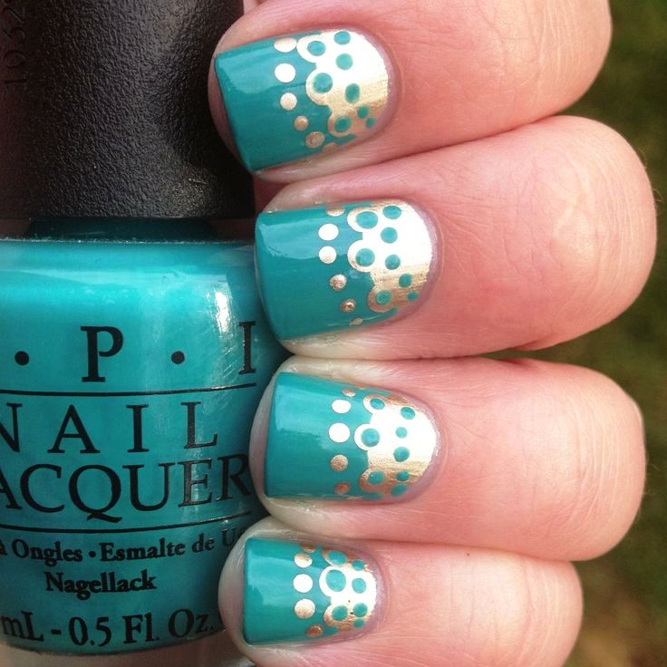 mint-nails-with-gold-metallic-polka-dots-design