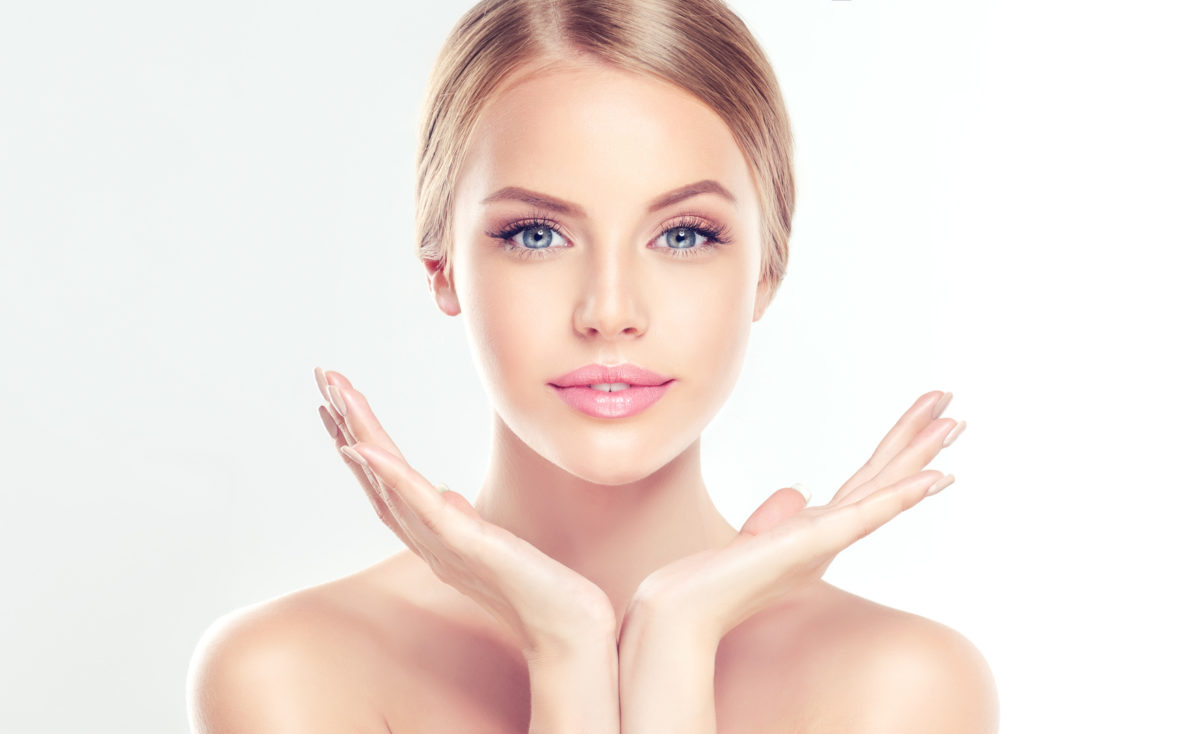 Beautiful Young Woman with clean fresh skin  . Facial  treatment   . Cosmetology , beauty  and spa .